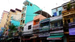 Brightly coloured buildings and ever present power cables - Ho Chi Minh City, Vietnam (4)