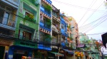 Façade of brightly coloured buildings and overhead power cables - Ho Chi Minh City, Vietnam (6)