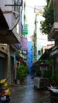Narrow alleyway with signs and mopeds - Ho Chi Minh City, Vietnam (7)