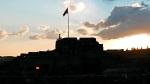 The Turkish flag of Kars Castle against the setting sun - Kars, Turkey (9)