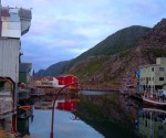 Village harbour and distinctive red house - Nyksund, Norway (1)