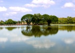 Barely visible ruins of Wat Mahathat seen from across a lake - Sukhothai Historical Park, Thailand (11)