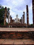 Seated Buddha, flanked by columns at Wat Mahathat - Sukhothai Historical Park, Thailand (6)