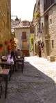 Couples sitting down to eat on Main street - Ainsa, Spain (10)