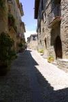 Shaded narrow alleyways of Aínsa old town, Main street - Ainsa, Spain (2)
