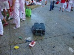An abandoned suitcase lies forgotten amongst the partygoers - San Fermín - Pamplona, Spain (9)