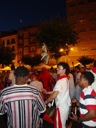 Drummers and revelers on the illuminated Castle square - San Fermín - Pamplona, Spain (16)
