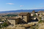 Isolated medieval stone buildings and surrounding countryside and mountains - Sos del Rey Catolico, Spain