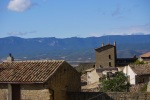 Stone buildings and Pyrenees peaks in the distance - Sos del Rey Catolico, Spain