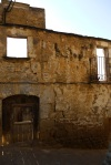 The remaining stone façade of a medieval stone building - Sos del Rey Catolico, Spain