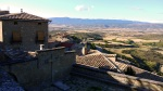 View across rooftops of Sos, with prominent stone cross - Sos del Rey Catolico, Spain