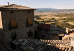 Typical medieval stone buildings and rooftops cast in shadow - Sos del Rey Catolico, Spain