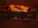 Man asleep on a bench feeling the effect of alcohol - San Fermín - Pamplona, Spain (3)