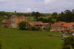 The stone buildings, orange roofs and surrounding fields of Santillana del Mar - Santillana del Mar, Spain (16)