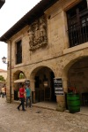 Imposing crest and medieval arched restaurant on Calle del Racial - Santillana del Mar, Spain (4)