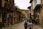 View along Calle la Carrera, the principal street of Santillana, with tourists enjoying the sights - Santillana del Mar, Spain (5)