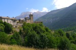 Torla Church with surrounding greenery and mountains - Torla, Spain (3)