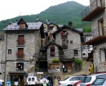 Stone buildings and cars on Aragon square - Torla, Spain (8)