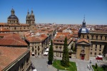 View from the top of the cathedral, Plaza Anaya and the Palacio de Anaya below and the dome of La Clerecía to the left - Salamanca, Spain