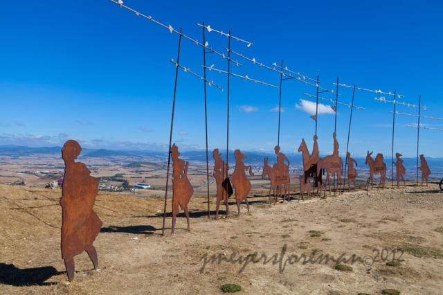 Cast iron pigrim silhouette statues on the ridge of Alto de Perdon - by Janice Meyers Foreman, Walking the Camino de Santiago, Spain