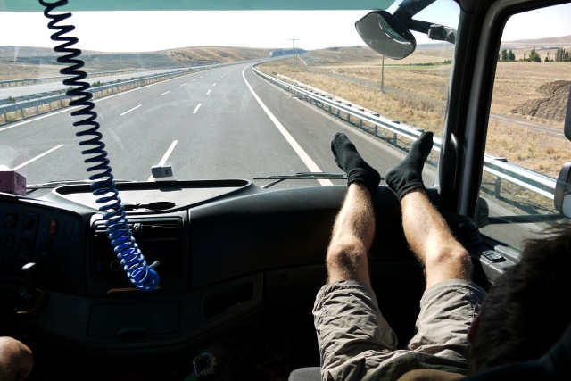 Jon's hairy legs on a lorry's dashboard while hitch-hiking in Turkey