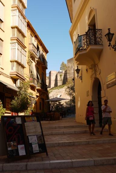 Málaga, Spain (4) - Calle Santiago with the Alcazaba de Málaga in the background