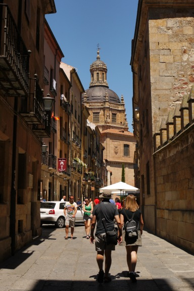 People walking down Calle Libreros, with Church of the Holy Spirit at the street's end - Salamanca, Spain (80)