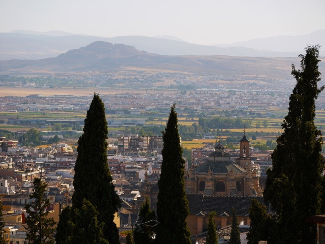 Granada, Spain  (160) - View across Catedral de Granada and on to surrounding countryside, taken from Mirador de San Nicolás in Barrio El Albayzín