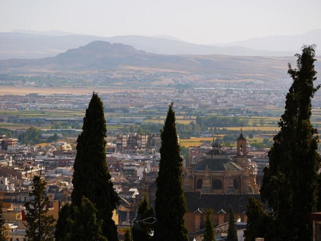 Granada, Spain  (160) - View across Catedral de Granada and on to surrounding countryside, taken from Mirador de San Nicolás in Barrio El Albayzín