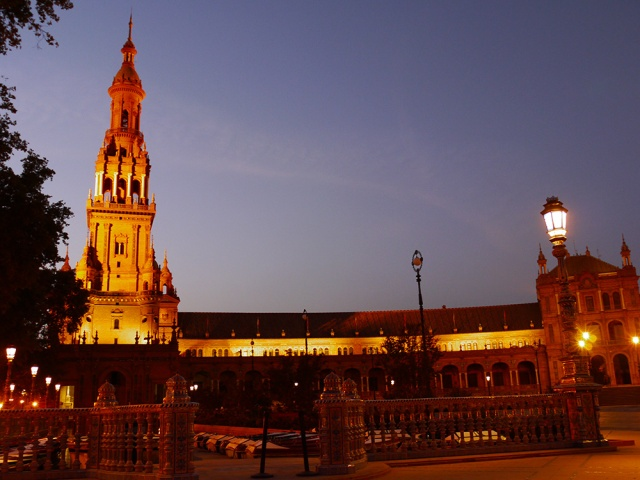 Sevilla, Spain (75) - The illuminated North Tower and pavilion buildings on Plaza de España, taken in Parque de María Luisa