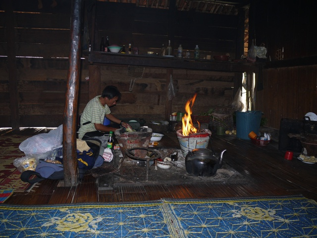 Traditional hut in northern Thailand - our guide preparing the evening meal