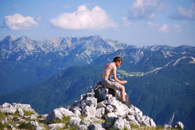 Our hike to Pršivec, Julian Alps, Bohinj, Slovenia - Jon eating a sandwich on top