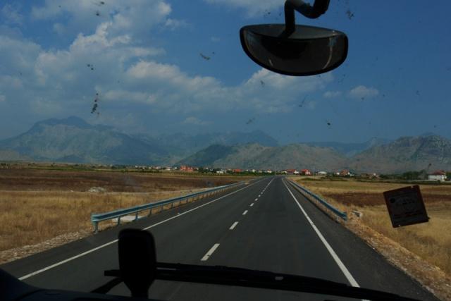 Albanian landscape through a truck's window
