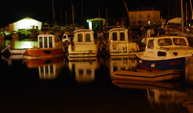 Boats in Krk, Croatia by night - small