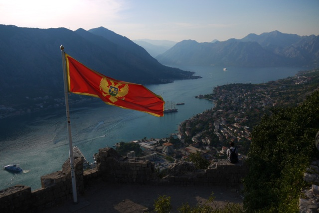 Montenegro flag flying above Kotor Fortress