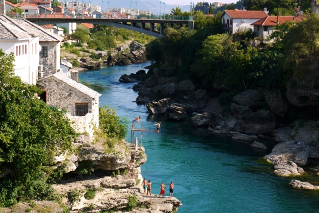 People diving into the river in Mostar, Bosnia and Herzegovina