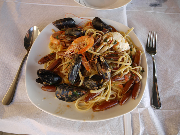 Pasta with seafood served in a beach restaurant near Spille, Albania