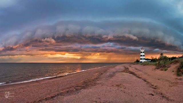 Deepti Suddul Photography - Storm cloud over West Point Lighthouse, PEI, Canada